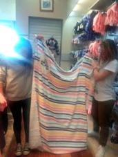 A beach towel bigger than the smallest team member